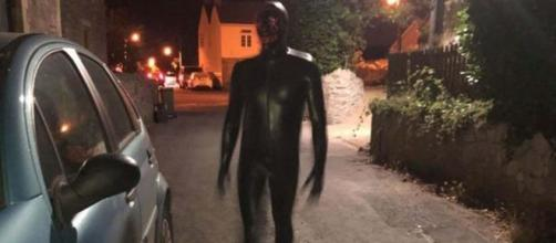 A man wearing a black rubber gimp suit is terrorising villagers in Claverham, Somerset [Image fabiano henrique araujo/YouTube]