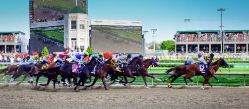 The Kentucky Derby is a Grade I stakes race for the three-year-old thoroughbred horses. [Image Source: Kentucky Derby GPA Photo Archive/Flickr ]