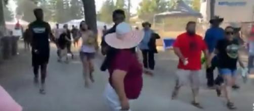 Crowd runs after hearing gunshots at California Garlic Festival. [Image source/NBC News YouTube video]