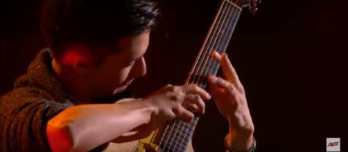 Virtuoso guitarist Marcin Patrzalek has Julianne Hough's prediction to take the 'America's Got Talent' title. [Image Source: AGT/YouTube]