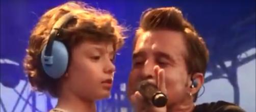 "Scott Stapp is all heart singing ""Face of the Sun"" on stage with his son, Daniel, as a big birthday moment. [Image source: cindyward19-YouTube]"
