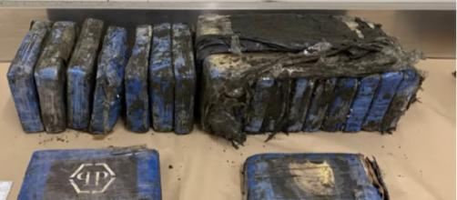 Parcels of cocaine wash up on west Auckland beach. [Image source/RNZ YouTube video]