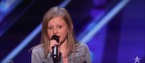 'America's Got Talent' contender Ansley Burns gets the surprise of her life with a saving vote. [Image source: Talent Recap/YouTube]