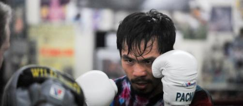 Manny Pacquiao will continue to pursue legacy-enhancing fights over the next year. [Image Source: Dan Johanson/Flickr]