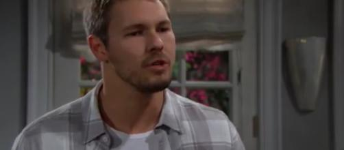 Ridge catches Liam arguing with a Comoros Thomas on Thursday.(Image Source: CBS-YouTube.)