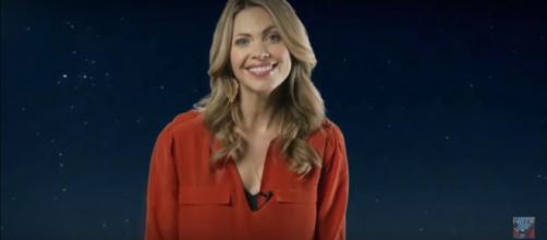 """Pascale Hutton and her """"When Calls the Heart"""" castmates have big smiles on the bus ride to begin Season 7. [Image source: Strombo-YouTube]"""