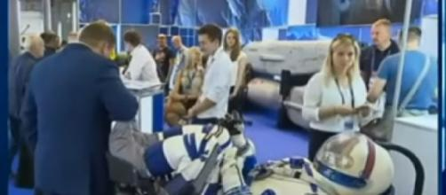 Russian Cosmonauts reveal sleek new Space Suit! Next Gen of explorers won't be in rubber! [Image source/Vesti News YouTube video]