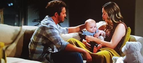 Hope and Liam are overjoyed that baby Beth has been with them all along. [Image source: CBS / YouTube]