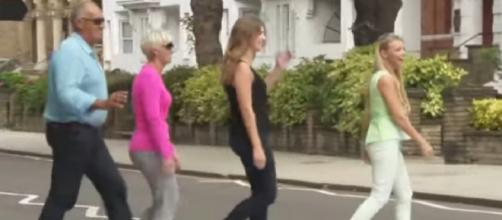 Beatles fans recreate the famous Beatles Abbey Road photo on 50th anniversary. [Image source/NBC News YouTube video]