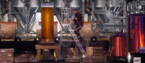 """America's Got Talent"" magician Dom Chambers downs a giant beer in his semifinals performance. [Image source:AGT-YouTube]"