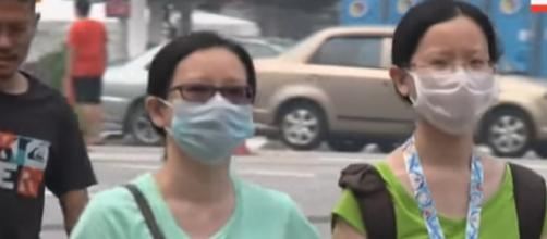 Kuala Lumpur health worries over thickening haze. [Image source/AP Archive YouTube video]