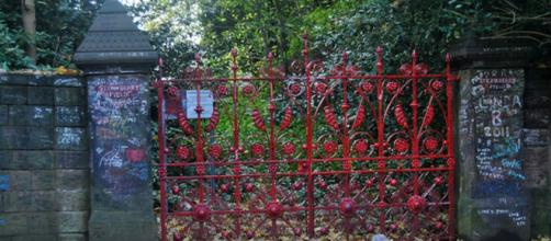 The famous red gates at Strawberry Field open to the public (Image Credit: Loco Steve/Flickr)