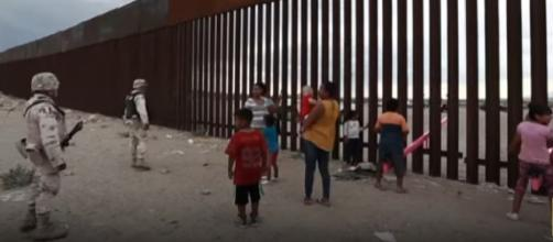 Seesaws cut through Mexico-U.S. border wall. [Image source/CGTN YouTube video]