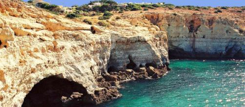 The Algarve coastline is made up of rocky crags, caves and cliffs [Image by Vitor Oliveira/Flickr]