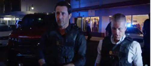 Steve (Alex O'Loughlin) isn't alone with an evening interrupted on the 'Hawaii Five-O' Season 10 premiere. [Image source: TVSpoilers/YouTube]