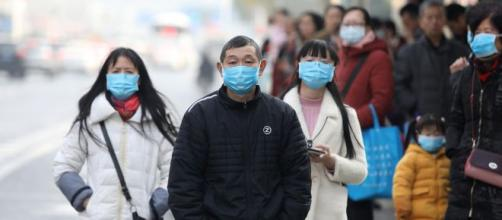 Coronavirus: i cittadini cinesi si proteggono.