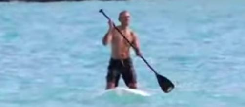Former President Obama paddle boards shirtless Hawai. [Image source/C FourYou YouTube video]
