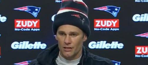 Brady and Watson played together from 2004 to 2009. [Image Source: New England Patriots/YouTube]