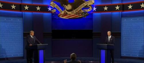 The first debate between Donald Trump and Joe Biden was moderated by Chris Wallace of Fox News [Image Source: Global News/YouTube]