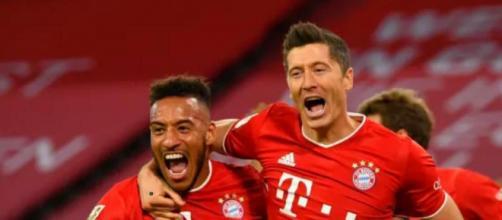 Nella foto Tolisso e Lewandowski.