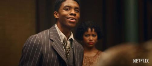 Boseman, who died after a four year battle with Colon Cancer, gives an award worthy performance. [YoutubeScreenshot/Netflix