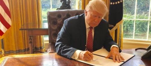 Trump signing an executive order [Image source: Wikipedia Commons]