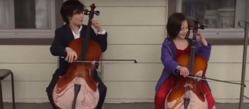Taran and Calliope Tien wanted to give more than a virtual performance for a neighbor performance for a neighbor. [Image Source: CBS/YouTube]