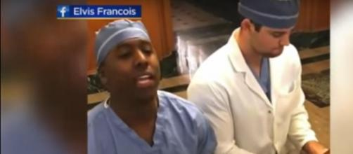 Mayo Clinic surgical resident, Elvis Francois, understands music's power to go where surgery and medicine cannot. [Image source: WCCO-YouTube]