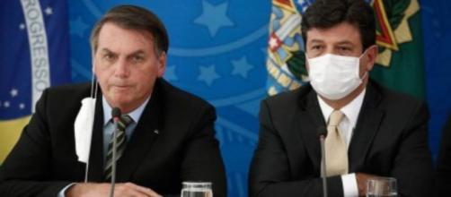 Presidente Jair Bolsonaro e o ministro da Saúde, Luiz Henrique Mandetta. (Reprodução/Globo).