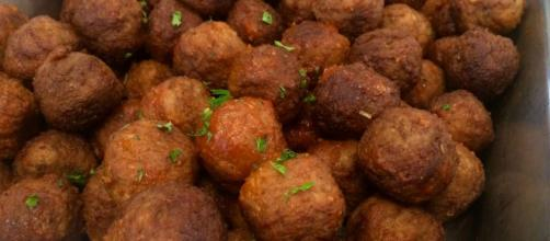 Meatballs can be served with a multitude of other items on the table. [Image Source: Steven Depolo/ Flickr]