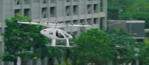 One of Volocopter's flying taxis over Marina Bay, Singapore. [Image source/CAN YouTube video]