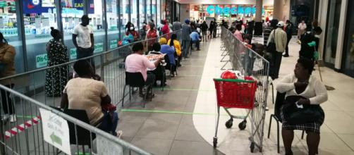 Shopping queues during Lockdown, Hillcrest South Africa. [Photo by Hendrik du Preez]