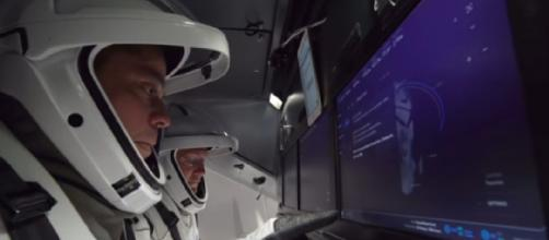 Commercial crew astronauts inside SpaceX's Crew Dragon. [Image source/SciNews YouTube video]