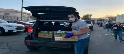 Fmr. Rep. Ruben Kihuen distributing food to Las Vegas community. [Image Source: Ruben Kihuen/Facebook]