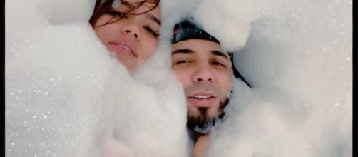 """Karol G and her fiancee Anuel AA collaborated for the song """"Follow"""". [Image Source: Karol G- YouTube]"""