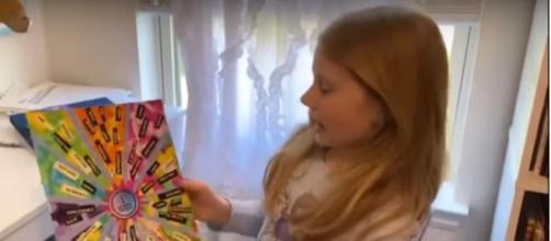 """Stella shows """"CBS This Morning"""" her """"empower poster"""" as part of a look at the pandemic through children's eyes.[Image source:CBS-YouTube]"""