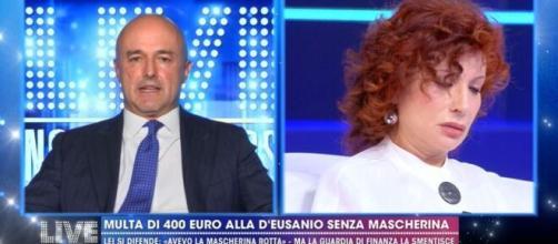 Nuzzi contro D'Eusanio: a Live Non è la D'Urso scontro sul caso della multa di 400 euro alla giornalista che non avrebbe indossato la mascherina.