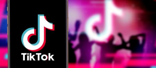 Smartphone with TIK TOK logo, which is a popular social network on the internet. [Image Source: Daniel Constante/Shutterstock]