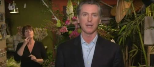 Newsom speaks on mail-in voting. [Image source: Los Angeles Times/YouTube]