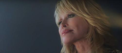"""Dolly Parton believes for better days and better people in her affirming new song, """"When Life Is Good Again.""""[Image source:DollyParton-YouTube]"""