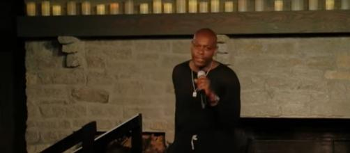 "Dave Chappelle put purpose and his personal anguish in front of the punch lines for his ""8:46"" special. [Image source:Access-YouTube]"