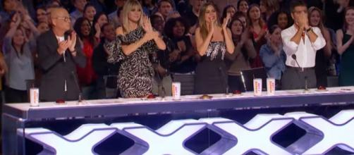 Simon Cowell covered his mouth in awe of W.A.F.F.L.E. Crew before giving them an 'America's Got Talent' golden buzzer. [Image source:AGT/YouTube]