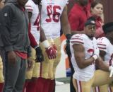 Members of the San Francisco 49ers kneeling for the anthem before a game. [image source: Keith Allison- Wikmedia Commons]