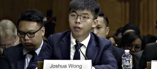 Joshua Wong is barred from running in the elections to LegCo, Hong Kong's Legislative Council. [Image source: Washington Post/YouTube Video]