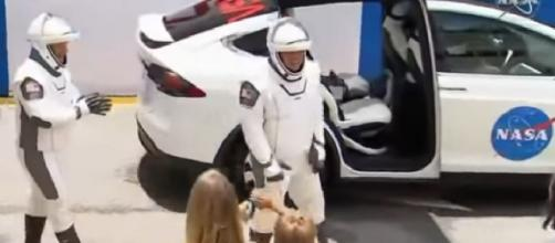 SpaceX Demo-2 astronauts wave goodbye to their families. [Image source/ABC News YouTube video]