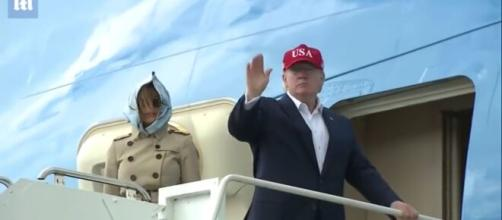President Trump waving as he enters the Air Force One. [Image Source: YouTube/Daily Mail, UK]