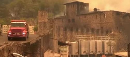 Flames damage Napa Valley's famed castle Winery Castello di Amarosa in California. [Image source/NBC Bay Area YouTube video]