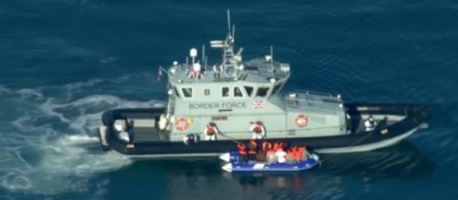 Record number of migrants cross English Channel - navy may be called in. [Image source/Channel 4 News YouTube video]