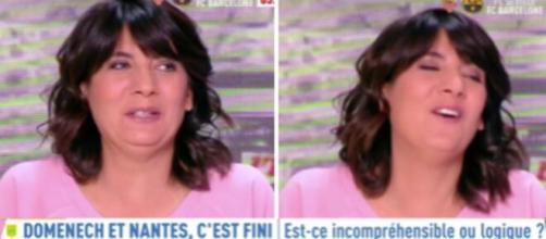 Estelle Denis n'a pu s'empêcher de rire au moment de parler de l'éviction de Raymond Domenech. ©Capture L'Equipe
