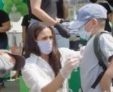 Meghan and Harry volunteer with Los Angeles Charity Baby2Baby. [Image source/Hugo Talks YouTube video]